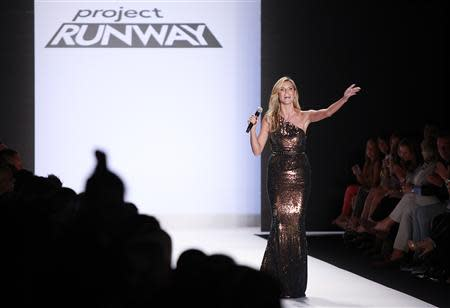 Project Runway judge Heidi Klum waves to the crowd following the Project Runway Spring 2014 collection show at New York Fashion Week September 6, 2013. REUTERS/Carlo Allegri