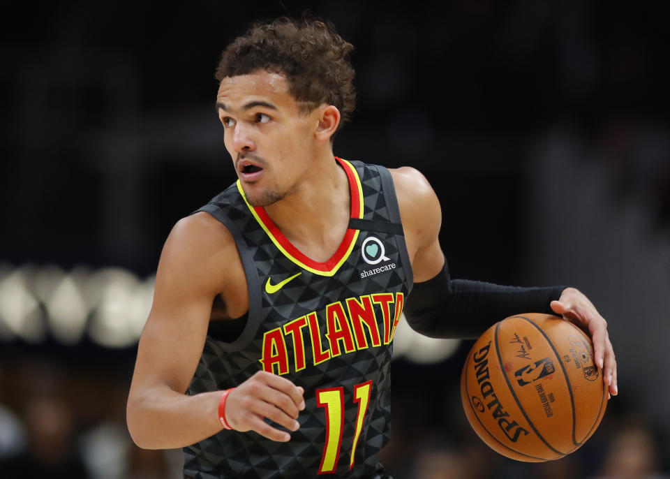 ATLANTA, GA - MARCH 09: Trae Young #11 of the Atlanta Hawks controls the ball during the second half of an NBA game against the Charlotte Hornets at State Farm Arena on March 9, 2020 in Atlanta, Georgia. NOTE TO USER: User expressly acknowledges and agrees that, by downloading and/or using this photograph, user is consenting to the terms and conditions of the Getty Images License Agreement. (Photo by Todd Kirkland/Getty Images)