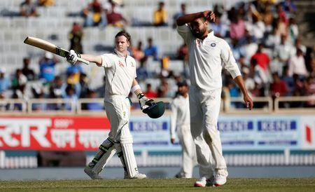 Cricket - India v Australia - Third Test cricket match - Jharkhand State Cricket Association Stadium, Ranchi, India - 16/03/17 - Australia's Steven Smith (L) celebrates his century. REUTERS/Adnan Abidi
