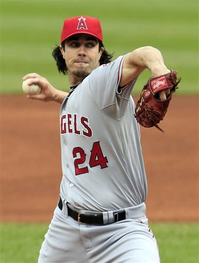 Los Angeles Angels starter Dan Haren pitches in the first inning of a baseball game against the Cleveland Indians, Saturday, April 28, 2012, in Cleveland. (AP Photo/Tony Dejak)