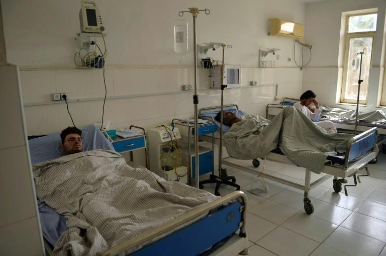 Victims who were injured in October 8 suicide bombing at the Gozar-e-Sayed mosque, rest inside a regional hospital in Kunduz (AFP/Hoshang Hashimi)