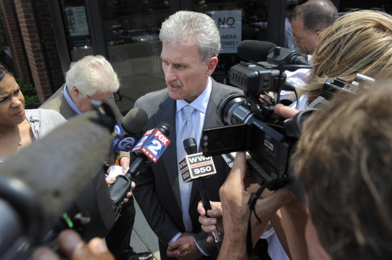 Attorney Mitchell Ribitwer speaks about his client Sandra Layne, accused in the shooting death of her grandson, Monday, May 21, 2012. A 74-year-old woman was arraigned Monday on an open murder charge in the shooting death of her 17-year-old grandson in the suburban Detroit condo they shared. (AP Photo/The Detroit News, Max Ortiz)