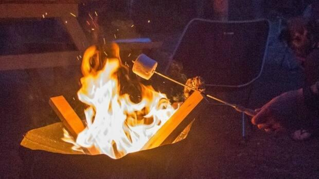 Campers are reminded to check for local restrictions before lighting a fire and ensure burning is done in a safe and responsible manner and in accordance with regulations. (Robson Fletcher/CBC - image credit)