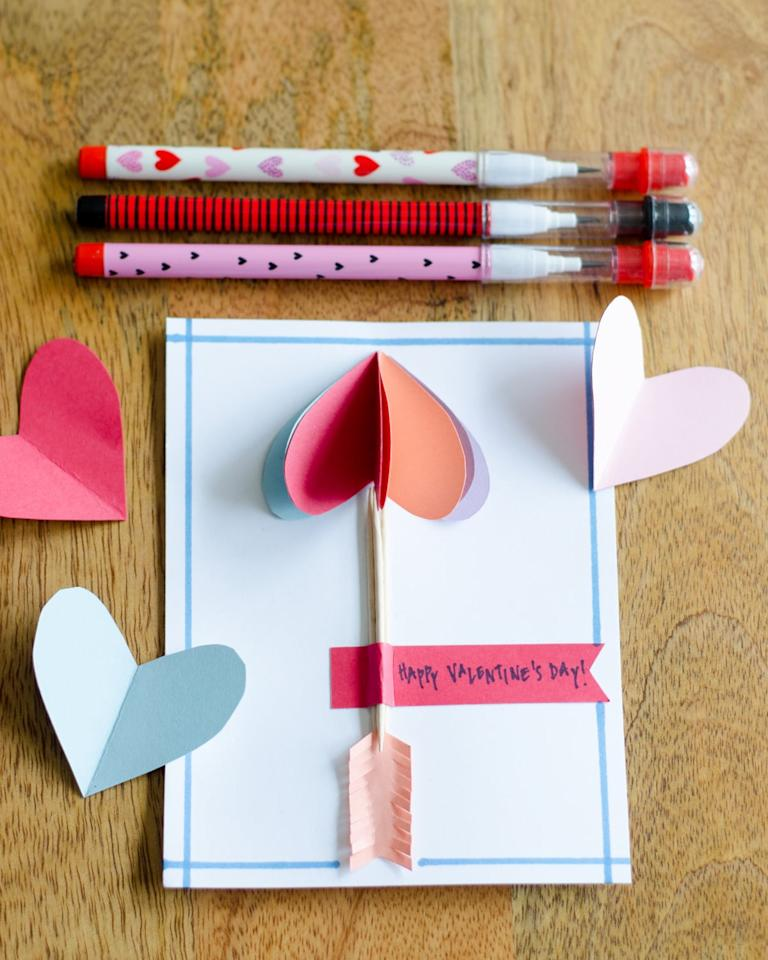 """<p>The Chronicles of Home's <a href=""""https://www.thechroniclesofhome.com/2018/01/easy-diy-valentines.html"""" target=""""_blank"""" class=""""ga-track"""" data-ga-category=""""Related"""" data-ga-label=""""https://www.thechroniclesofhome.com/2018/01/easy-diy-valentines.html"""" data-ga-action=""""In-Line Links"""">easy DIY valentines</a> use folded paper hearts to create cute 3D cards. First step: simply fold a piece of paper in half, cut out a half-heart shape, and open it up to reveal a perfectly symmetrical heart.</p>"""