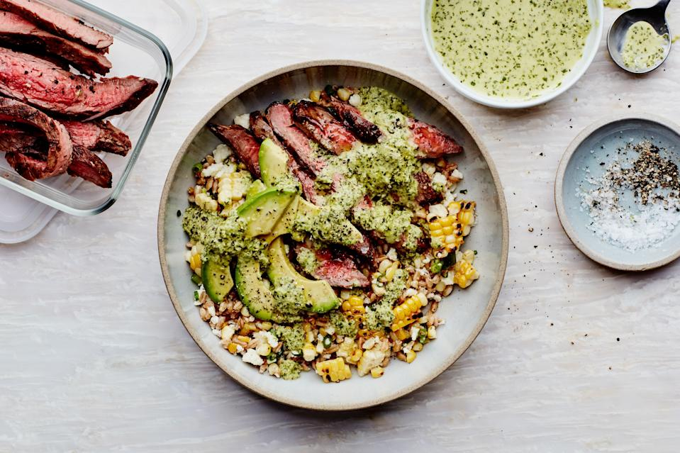 """Prep the grilled elements of this dinner over the weekend and store them in your fridge for a Tex-Mex-inspired grain bowl you can assemble in just 10 minutes. <a href=""""https://www.epicurious.com/recipes/food/views/grain-bowls-with-grilled-corn-steak-and-avocado?mbid=synd_yahoo_rss"""" rel=""""nofollow noopener"""" target=""""_blank"""" data-ylk=""""slk:See recipe."""" class=""""link rapid-noclick-resp"""">See recipe.</a>"""