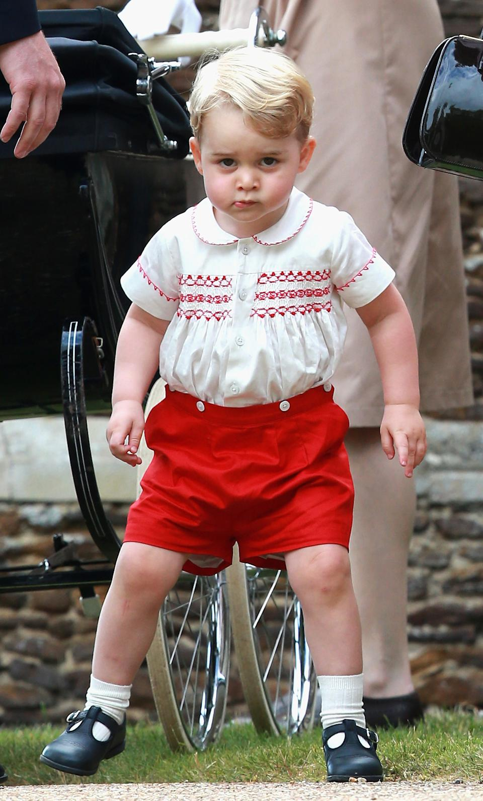 Prince George of Cambridge leaves his sister Charlotte's christening at St. Mary Magdalene Church in Sandringham, England, on July 5, 2015. Britain's baby Princess Charlotte was christened on Sunday in her second public outing since her birth nine weeks ago to proud parents Prince William and his wife Kate. The low-key ceremony took place in a church on the country estate of great grandmother Queen Elizabeth II. AFP PHOTO / POOL / CHRIS JACKSON (Photo by Chris Jackson / POOL / AFP) (Photo by CHRIS JACKSON/POOL/AFP via Getty Images)