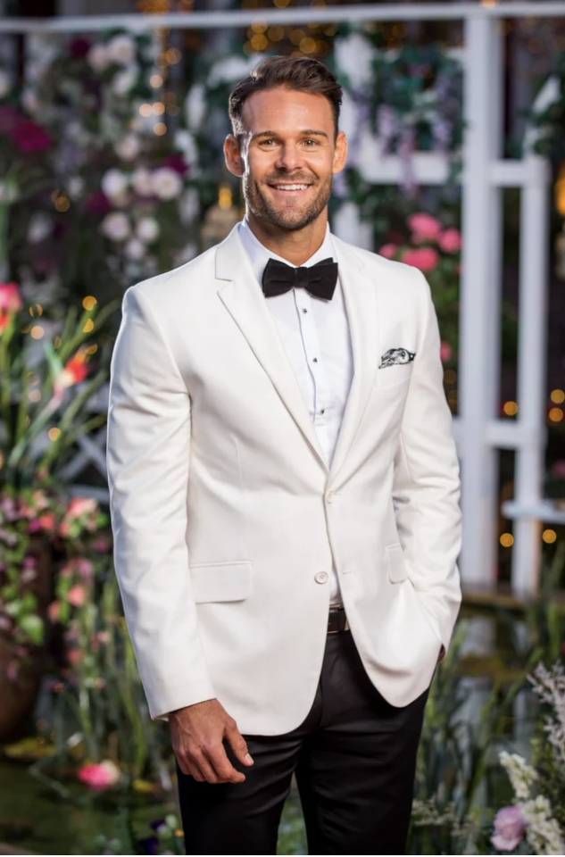 Carlin caught Ange's attention in this sharp suit on the first night of the Bachelorette. Photo: Ten