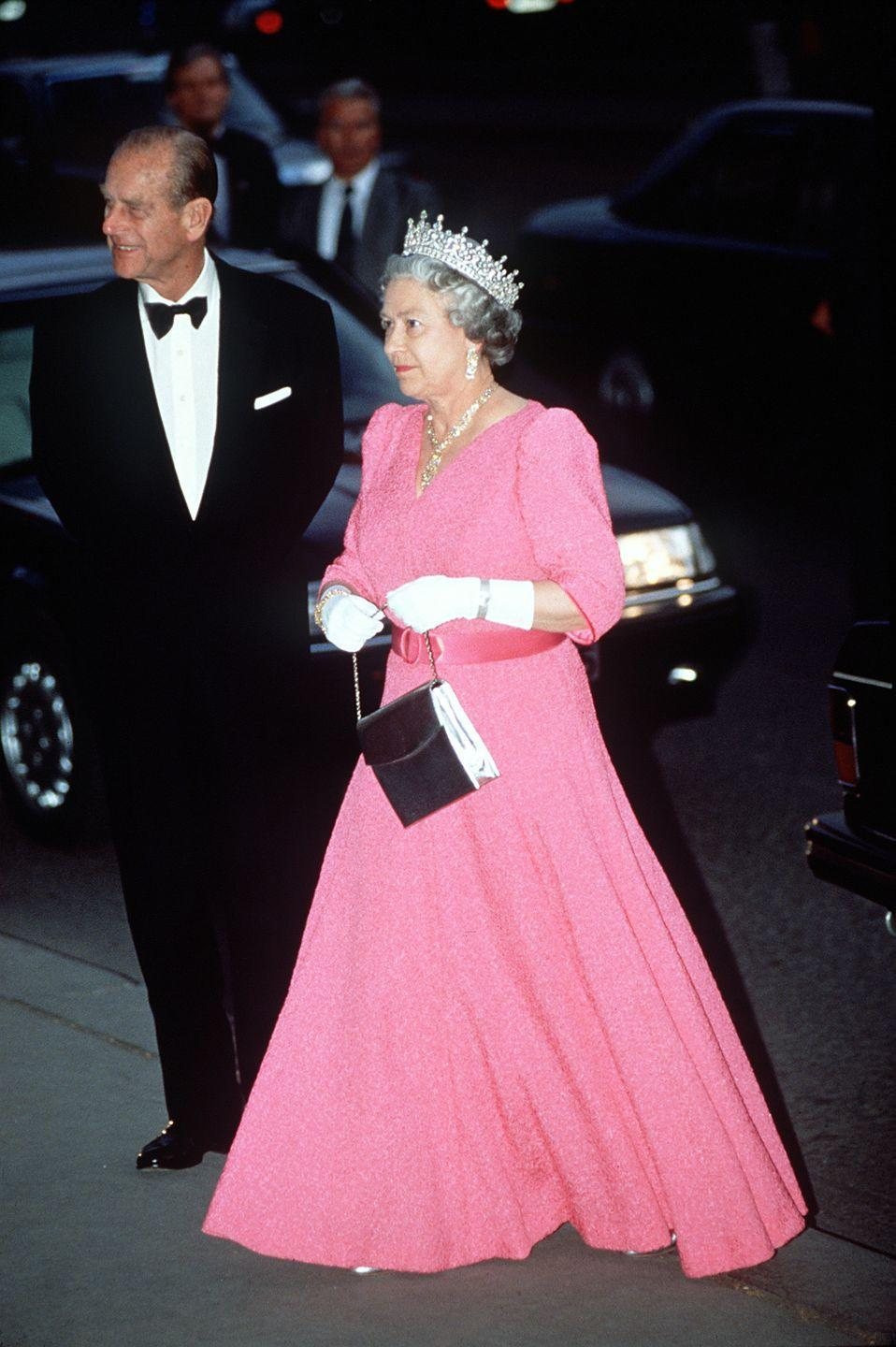 <p>Queen Elizabeth wore a dress that matched Aurora's signature pink for a banquet in Hungary in 1993. She topped the flowing gown off with the Ireland Tiara. </p>