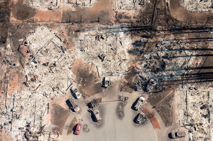 <p>OCT. 12, 2017 – In this aerial view, a burned neighborhood is seen in Santa Rosa, California.<br> Hundreds of people are still missing in massive wildfires which have swept through California killing at least 26 people and damaging thousands of homes, businesses and other buildings. (Josh Edelson/AFP/Getty Images) </p>