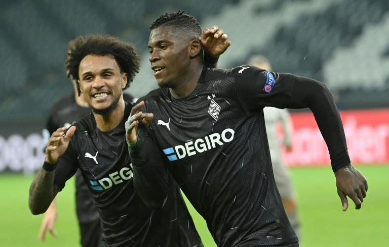 Breel Embolo (R) celebrates his superb goal in Moenchengladbach's win over Shakhtar Donetsk on Wednesday