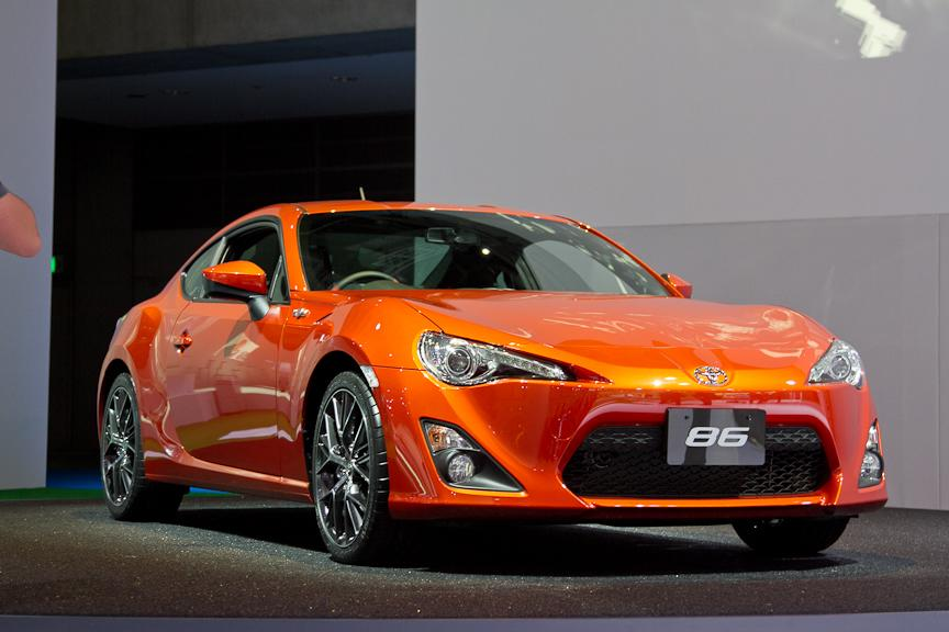 The spiritual successor to the Toyota Corolla/Sprinto Trueno with the chassis code AE86, the Toyota 86 is a lightweight RWD sports car created in conjunction with Subaru. With a curb weight under 2700 lbs and a center of gravity lower than the Ferrari 458 Italia, the Toyota 86 aims to be a consummate driver's car.