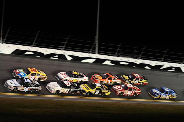DAYTONA BEACH, FL - FEBRUARY 18: Tony Stewart, driver of the #14 Office Depot/Mobil 1 Chevrolet, and Kyle Busch, driver of the #18 M&M's Brown Toyota, lead a pack during the NASCAR Budweiser Shootout at Daytona International Speedway on February 18, 2012 in Daytona Beach, Florida. (Photo by Jared C. Tilton/Getty Images for NASCAR)