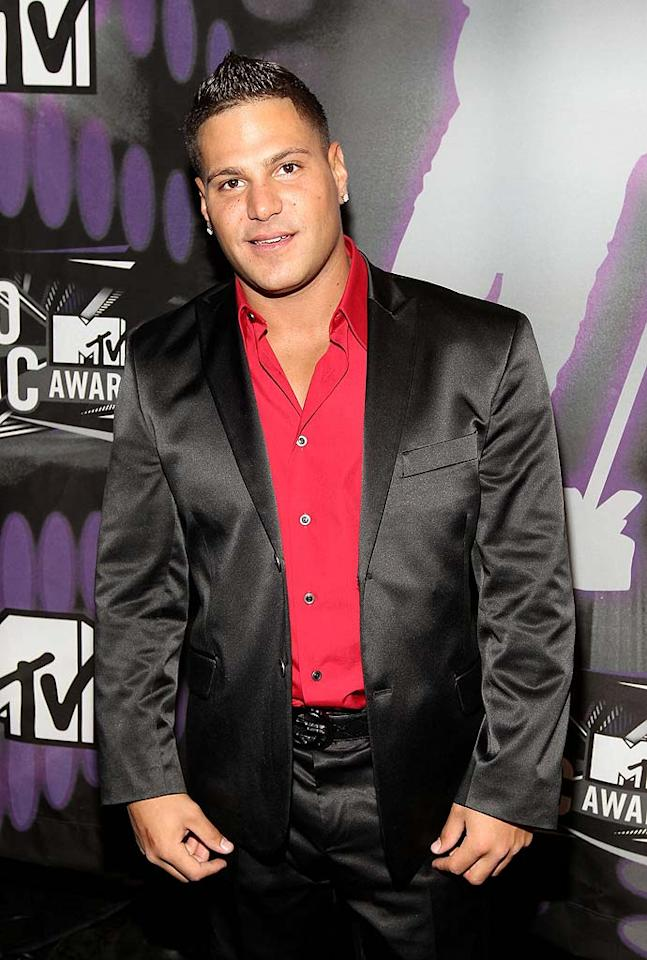 "The girls' ""Jersey Shore"" roomie, Ronnie Magro, looked quite sharp in a shiny black suit and bright red shirt. Christopher Polk/<a href=""http://www.gettyimages.com/"" target=""new"">GettyImages.com</a> - August 28, 2011"
