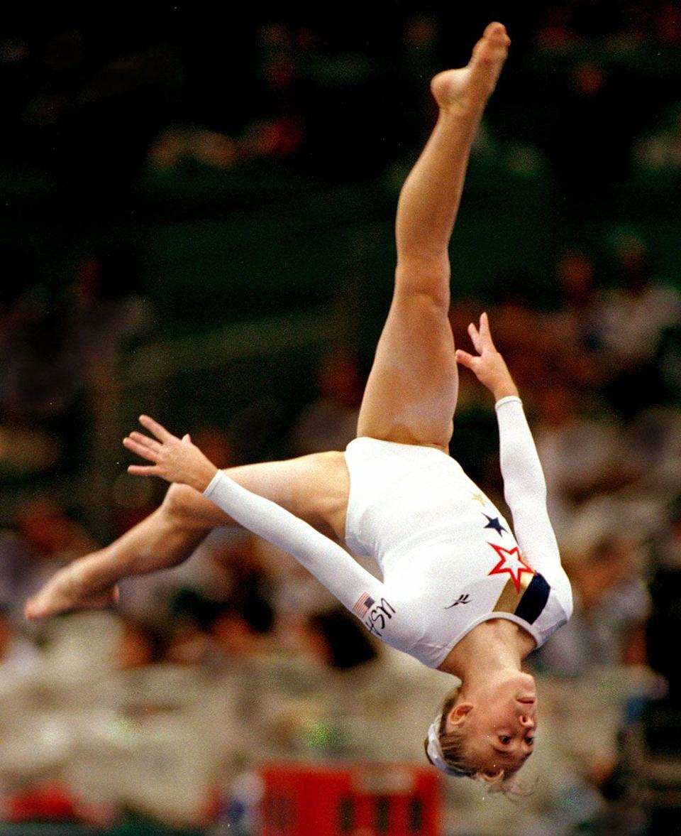 <p><em>Shannon Miller</em></p><p>She was the queen of gymnastics in the '90s, and that scrunchie was her crown. </p>