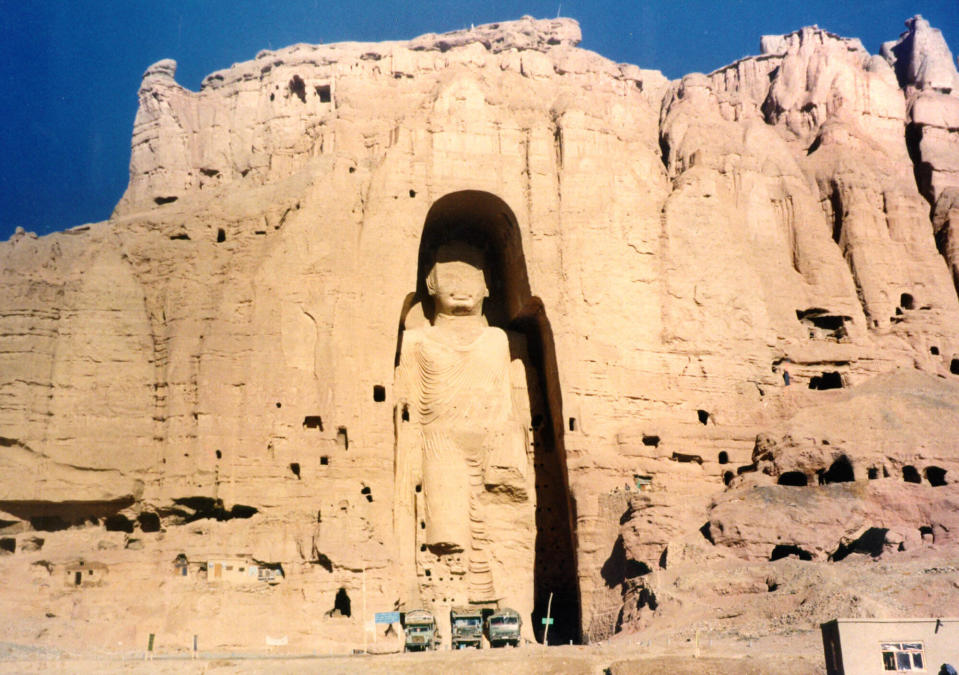 FILE - The 53-meter (175-foot) tall, 2000-year-old Buddha statue located in Bamyan, about 150 kilometers (90 miles) west of the Afghan capital Kabul, is shown in November 28, 1997, file photo. The former Soviet Union marched into Afghanistan on Christmas Eve, 1979, claiming it was invited by the new Afghan communist leader, Babrak Karmal, setting the country on a path of 40 years of seemingly endless wars and conflict. After the Soviets left in humiliation, America was the next great power to wade in. (AP Photo/Zaheeruddin Abdullah)