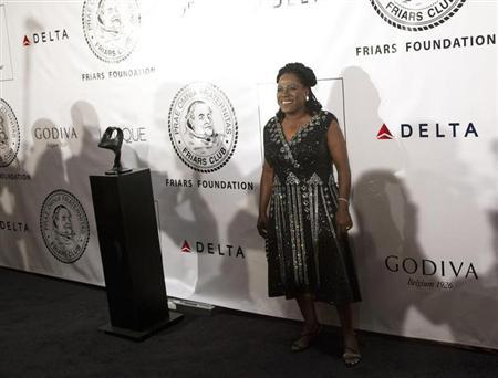 Singer Sharon Jones poses as she arrives before The Friars Club and Friars Foundation honored Tom Cruise with the Entertainment Icon Award in New York