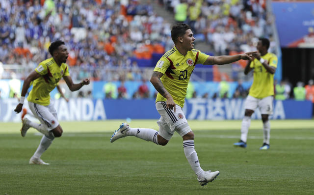 Colombia's Juan Quintero celebrates after scoring his side's first goal during the group H match between Colombia and Japan at the 2018 soccer World Cup in the Mordavia Arena in Saransk, Russia, Tuesday, June 19, 2018. (AP Photo/Natacha Pisarenko)