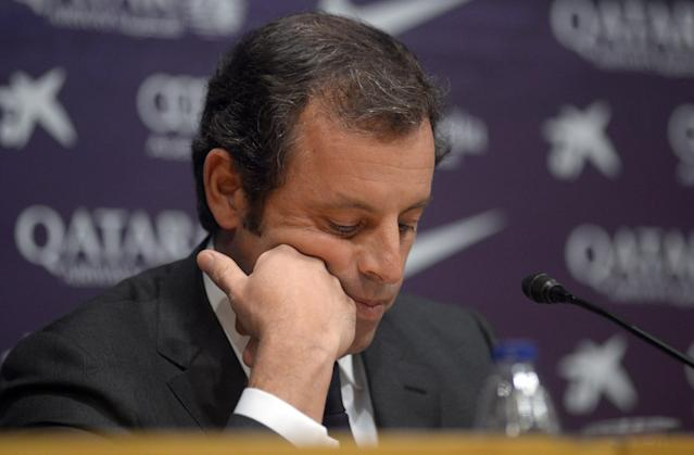 FC Barcelona's president Sandro Rosell, looks down during a press conference at the Camp Nou stadium in Barcelona, Spain, Thursday, Jan 23, 2014. Sandro Rosell is stepping down as president of Barcelona a day after a judge agreed to hear a lawsuit accusing him of allegedly hiding the cost of the transfer of Brazil striker Neymar. Rosell says he is resigning after an emergency meeting with Barcelona's board of directors on Thursday. Rosell says vice president Josep Bartomeu will take his place as president and finish the term that expires in 2016. Elected in 2010 to replace outgoing president Joan Laporta, Rosell said last April he planned to run for re-election in 2016. (AP Photo/Manu Fernandez)