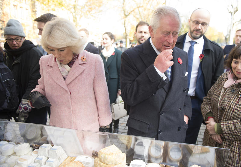 Britain's Prince Charles, Prince of Wales (R) and his wife Britain's Camilla, Duchess of Cornwall react during a visit to Swiss Cottage Farmers Market in London on November 6, 2019. (Photo by Eddie Mulholland / POOL / AFP) (Photo by EDDIE MULHOLLAND/POOL/AFP via Getty Images)
