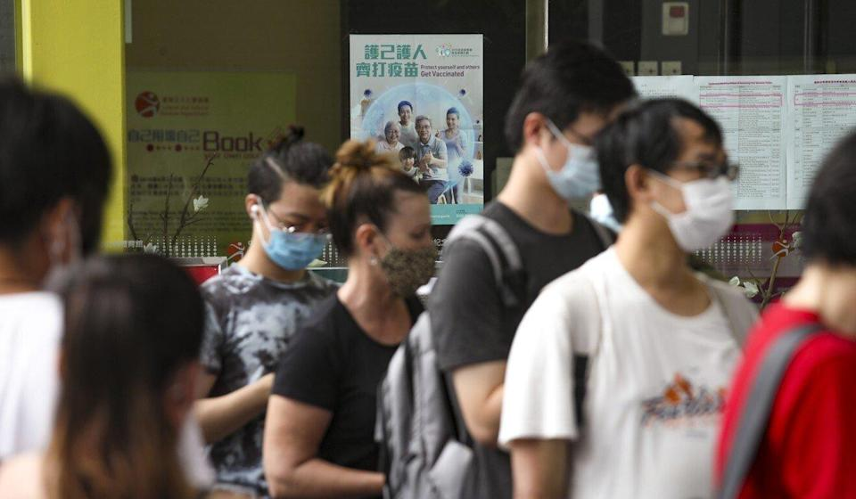 People queue up for coronavirus jabs at a community vaccination centre. One of the new studies will look at the efficacy of administering extra doses. Photo: Xiaomei Chen