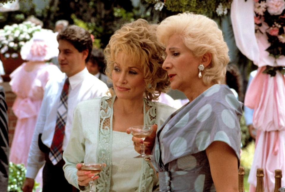 """<p>The '80s kicked off with a groundbreaking Dolly Parton comedy in <em>9 to 5</em>, so it's only natural that the decade concluded with another: <em>Steel Magnolias</em>, a movies about the bond of a group of Southern women that also stars Sally Field, Shirley MacLaine, Daryl Hannah, Julia Roberts, and Olympia Dukakis.</p> <p><em>Available to buy on</em> <a href=""""https://www.amazon.com/Steel-Magnolias-Sally-Field/dp/B000OLTMPE"""" rel=""""nofollow noopener"""" target=""""_blank"""" data-ylk=""""slk:Amazon Prime Video"""" class=""""link rapid-noclick-resp""""><em>Amazon Prime Video</em></a>.</p>"""