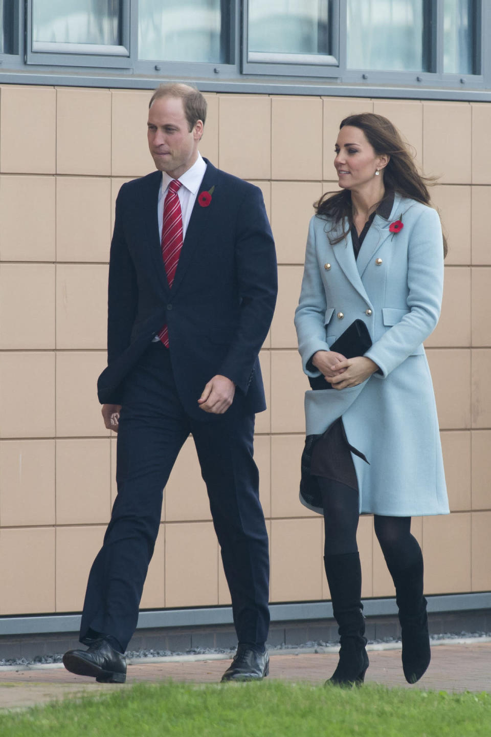 <p>The Duchess debuted a pale blue coat by British designer Matthew Williamson for a day in Wales. Underneath, she wore a brown shirt dress from Hobbs and accessorised with Aquatalia heeled boots and a Stuart Weitzman clutch. </p><p><i>[Photo: Getty]</i></p>