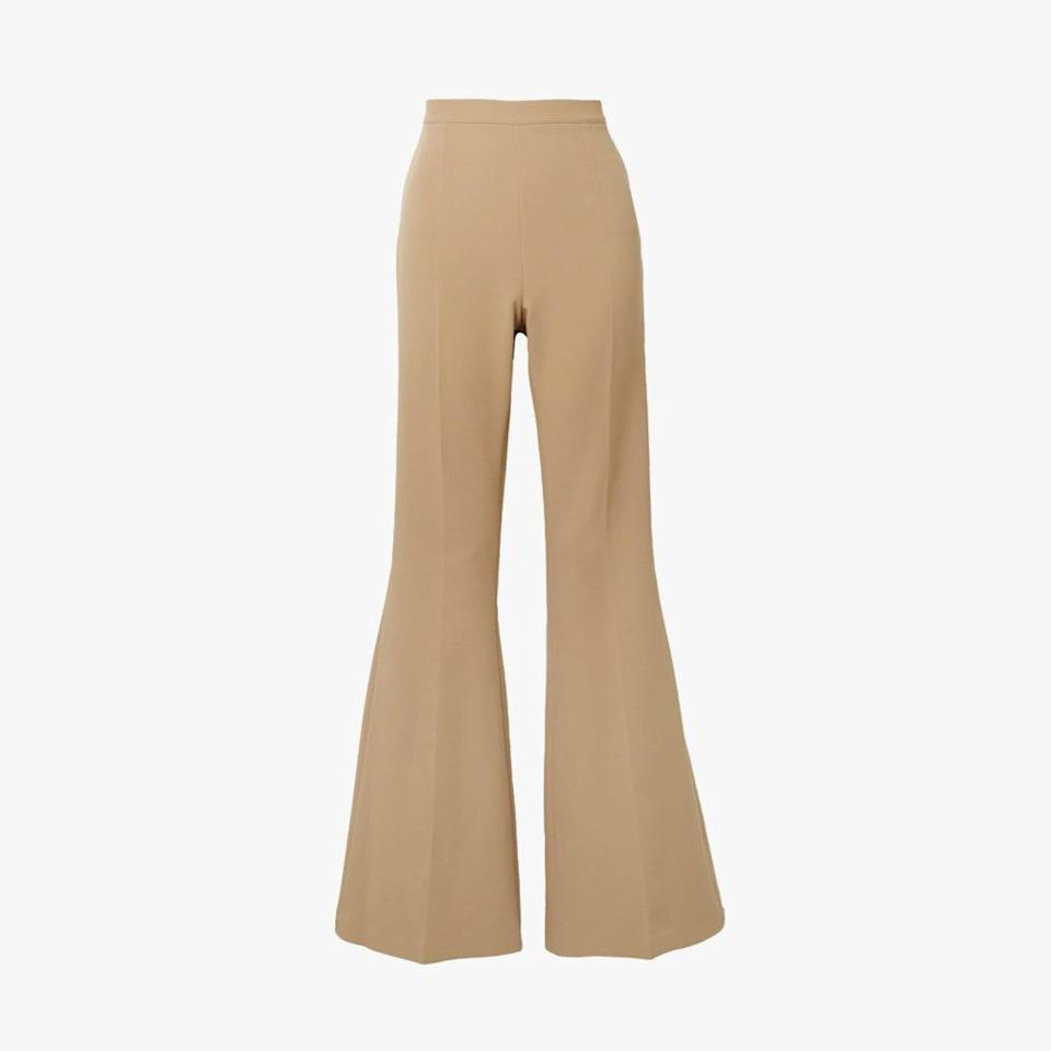 "$630, NET-A-PORTER. <a href=""https://www.net-a-porter.com/en-us/shop/product/safiyaa/halluana-stretch-crepe-flared-pants/1292209?cm_mmc=Google-ProductSearch-US--c-_-NAP_EN_US_PLA-_-NAP%C2%A0-%C2%A0US%C2%A0-%C2%A0GS%C2%A0-+Generic+-+Clothing%C2%A0-+Beachwear%C2%A0-%C2%A0High--Beachwear+-+Bikinis_AM&gclid=CjwKCAjw6fCCBhBNEiwAem5SO13l_owCwSTRr5gfPgyFrLLTC3UHX7pixbIdPJRDn7_RTKlZlwNP0hoCQZ8QAvD_BwE&gclsrc=aw.ds"" rel=""nofollow noopener"" target=""_blank"" data-ylk=""slk:Get it now!"" class=""link rapid-noclick-resp"">Get it now!</a>"
