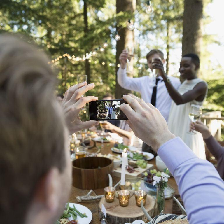 "<p>We get it: You really want to show off how much you love the newlyweds with their adorable Instagram hashtag<em> but</em> experts say it's best to wait until after they say ""I do."" ""Guests should refrain from taking photos or videos during the ceremony, if the couple asked them to,"" says Shawna Orwoll from <a href=""https://www.awaywegoweddings.com/"" rel=""nofollow noopener"" target=""_blank"" data-ylk=""slk:Away We Go Weddings"" class=""link rapid-noclick-resp"">Away We Go Weddings</a>. ""Religious or not, a wedding ceremony is a sacred moment for the couple and should be treated accordingly."" </p>"