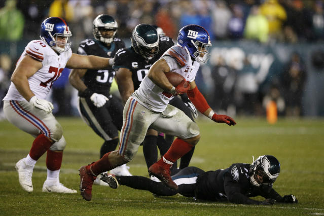 New York Giants' Saquon Barkley rushes during the second half of an NFL football game against the Philadelphia Eagles, Monday, Dec. 9, 2019, in Philadelphia. (AP Photo/Michael Perez)