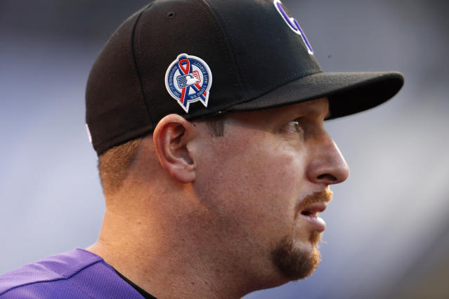 Colorado Rockies relief pitcher Bryan Shaw wears a special patch on his cap to mark the anniversary of the 9/11 terrorist attacks before a baseball game against the Arizona Diamondbacks, Tuesday, Sept. 11, 2018, in Denver. (AP Photo/David Zalubowski)