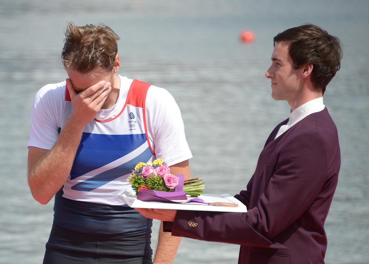 Great Britain's Alan Campbell cries as he receives his bronze medal on the podium, for the men's single sculls final A of the rowing event during the London 2012 Olympic Games, at Eton Dorney Rowing Centre in Eton, west of London, on August 3, 2012. AFP PHOTO / DAMIEN MEYERDAMIEN MEYER/AFP/GettyImages