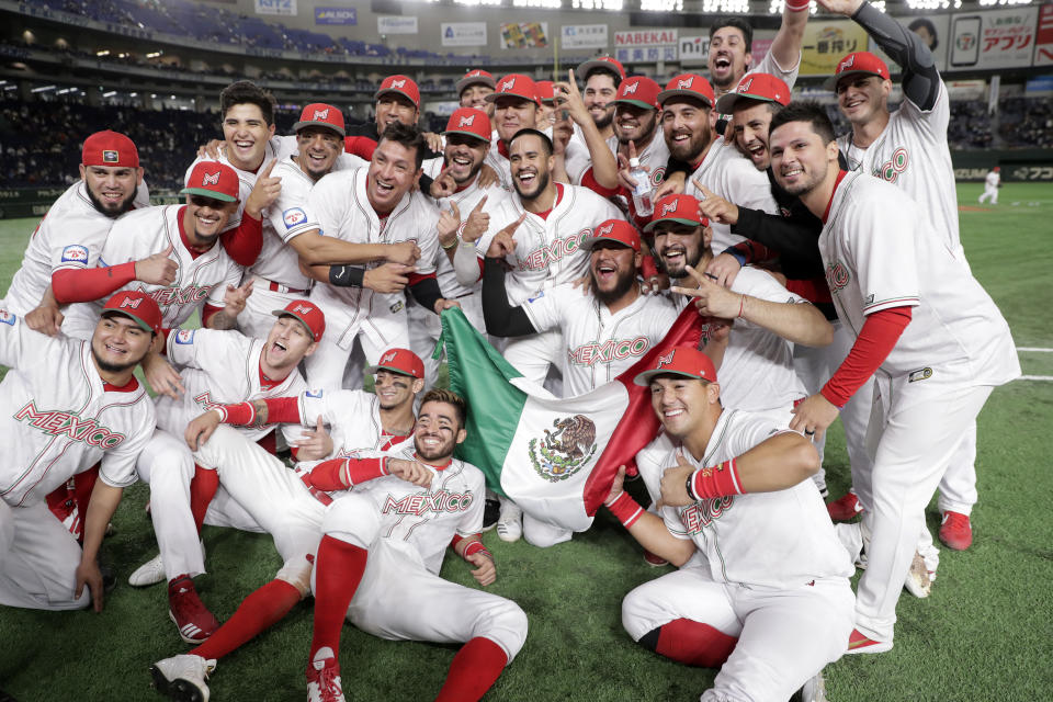 TOKYO, JAPAN - NOVEMBER 17: Mexico players celebrate their victory and qualification for the Tokyo 2020 Olympic Games after the WBSC Premier 12 Bronze Medal final game between Mexico and USA at the Tokyo Dome on November 17, 2019 in Tokyo, Japan. (Photo by Kiyoshi Ota/Getty Images)