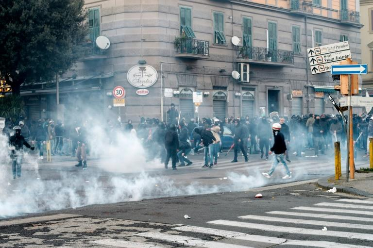 A group of people clash with police during a rally organized by citizens and social community against the political meeting of Matteo Salvini, general secretary of Italian far-right party Lega Nord on March 11, 2017 in Naples