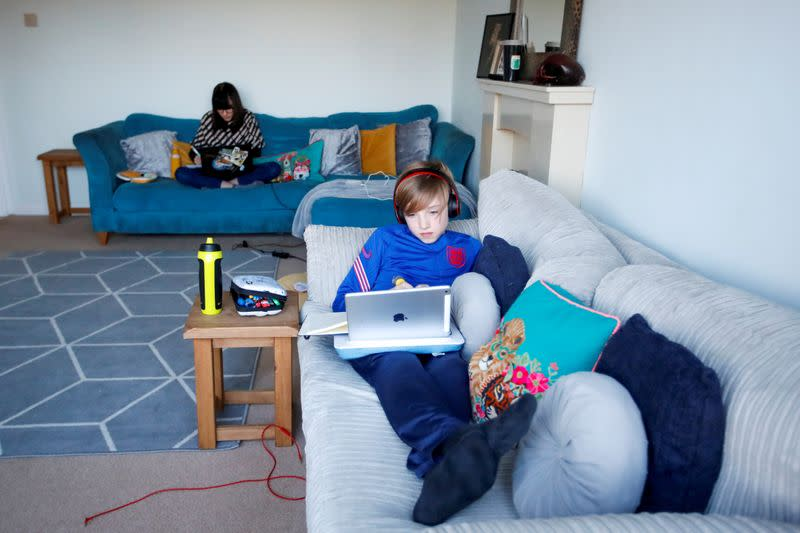 FILE PHOTO: Children attend school lessons at home in Milton Keynes