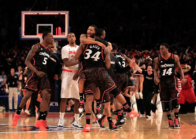 NEW YORK, NY - MARCH 09: Dion Dixon #3 hugs Yancy Gates #34 of the Cincinnati Bearcats as time expires against the Syracuse Orange during the semifinals of the Big East men's basketball tournament at Madison Square Garden on March 9, 2012 in New York City. (Photo by Chris Trotman/Getty Images)