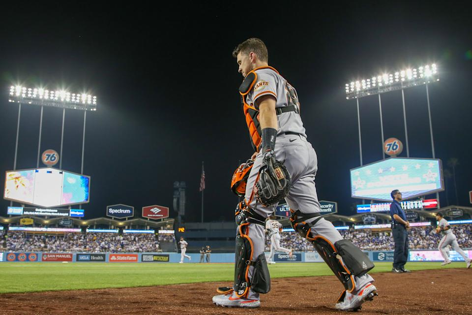 LOS ANGELES, CA - JUNE 28: San Francisco Giants Catcher Buster Posey (28) walks to a field during the MLB game between the San Francisco Giants and the Los Angeles Dodgers on June 28, 2021, at Dodger Stadium in Los Angeles, CA.  (Photo by Kiyoshi Mio/Icon Sportswire via Getty Images)