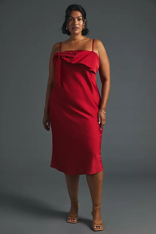 """<h2>Fall Wedding-Guest Midi Dresses</h2><br>Midi dresses are a classy choice for a fall wedding — plus, the length is just right for showing off your <a href=""""https://www.refinery29.com/en-us/heels"""" rel=""""nofollow noopener"""" target=""""_blank"""" data-ylk=""""slk:fancy shoes"""" class=""""link rapid-noclick-resp"""">fancy shoes</a> without your legs feeling overexposed. And if you're wearing a sleeveless number, you can always throw on a <a href=""""https://www.refinery29.com/en-us/blazers"""" rel=""""nofollow noopener"""" target=""""_blank"""" data-ylk=""""slk:blazer"""" class=""""link rapid-noclick-resp"""">blazer</a> or shrug for warmth.<br><br><strong>Hutch</strong> Bow-Front Slip Midi Dress, $, available at <a href=""""https://go.skimresources.com/?id=30283X879131&url=https%3A%2F%2Fwww.anthropologie.com%2Fshop%2Fbow-front-slip-midi-dress%3Fcolor%3D060%26type%3DSTANDARD%26quantity%3D1"""" rel=""""nofollow noopener"""" target=""""_blank"""" data-ylk=""""slk:Anthropologie"""" class=""""link rapid-noclick-resp"""">Anthropologie</a>"""