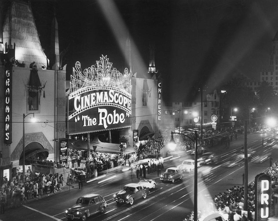 """<p>The era of CinemaScope widescreen films began with the premiere of <a href=""""https://www.nytimes.com/1953/09/17/archives/the-screen-the-rose-shown-in-cemascope-movie-based-on-douglas-novel.html"""" rel=""""nofollow noopener"""" target=""""_blank"""" data-ylk=""""slk:1953's"""" class=""""link rapid-noclick-resp"""">1953's </a><em><a href=""""https://www.nytimes.com/1953/09/17/archives/the-screen-the-rose-shown-in-cemascope-movie-based-on-douglas-novel.html"""" rel=""""nofollow noopener"""" target=""""_blank"""" data-ylk=""""slk:The Robe"""" class=""""link rapid-noclick-resp"""">The Robe</a></em>. Held at the Grauman's Chinese Theatre (now known as the TCL Chinese Theatre), it was a momentous occasion for the industry. </p>"""