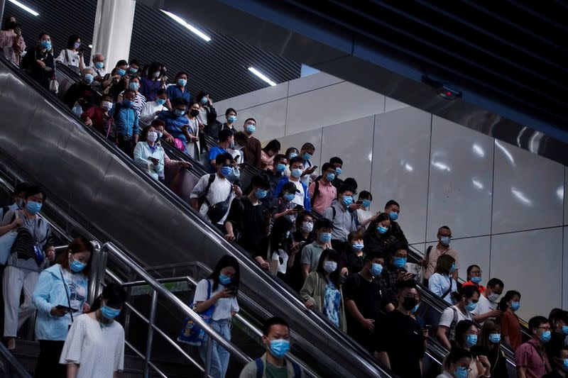 People walk at a subway station, following the outbreak of the coronavirus disease (COVID-19), in Shanghai