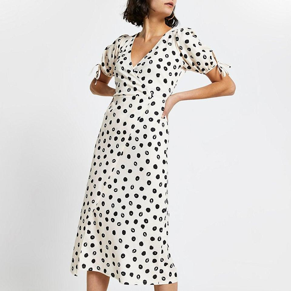 <p>I can wear this <span>River Island Wrap Spot Midi Dress</span> ($76) with tights and boots now, as well as sandals in the spring.</p>