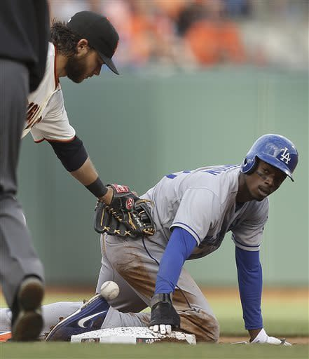Los Angeles Dodgers' Dee Gordon, right, steals second base as San Francisco Giants shortstop Brandon Crawford drops the ball in the fifth inning of a baseball game, Sunday, May 5, 2013, in San Francisco. (AP Photo/Ben Margot)