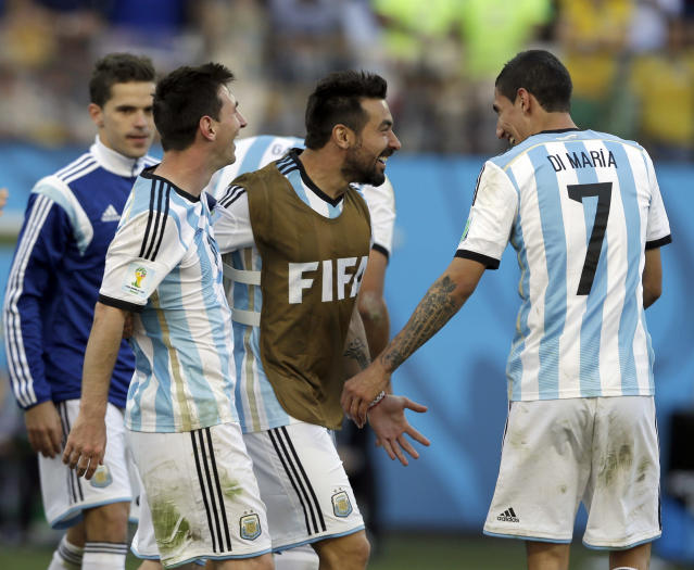 Argentina's Fernando Gago, left, Lionel Messi, Ezequiel Lavezzi and Angel di Maria celebrate after the World Cup round of 16 soccer match between Argentina and Switzerland at the Itaquerao Stadium in Sao Paulo, Brazil, Tuesday, July 1, 2014. Argentina beat Switzerland 1-0 after extra time. (AP Photo/Ricardo Mazalan)