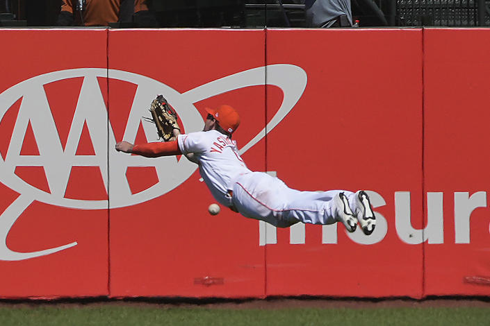 San Francisco Giants right fielder Mike Yastrzemski can not make the diving catch on a two-run triple by Washington Nationals' Alcides Escobar during the seventh inning of a baseball game Saturday, July 10, 2021, in San Francisco. (AP Photo/Tony Avelar)