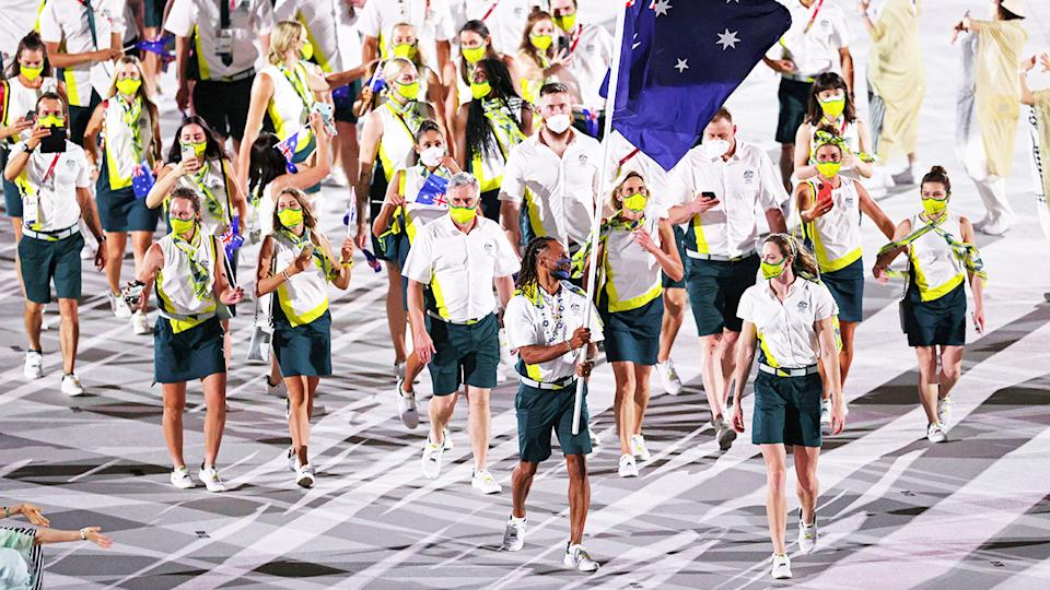 Patty Mills, pictured here becoming the first Indigenous athlete to carry the Australian flag.