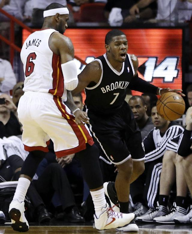 Brooklyn Nets' Joe Johnson (7) drives to the basket around Miami Heat defender LeBron James (6) in the first half of Game 1 in an NBA basketball Eastern Conference semifinal series, Tuesday, May 6, 2014, in Miami. (AP Photo/Lynne Sladky)