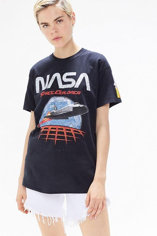 """<p>This <a href=""""https://www.popsugar.com/buy/NASA-Space-Explorer-Tee-477691?p_name=NASA%20Space%20Explorer%20Tee&retailer=urbanoutfitters.com&pid=477691&price=39&evar1=fab%3Aus&evar9=46478627&evar98=https%3A%2F%2Fwww.popsugar.com%2Fphoto-gallery%2F46478627%2Fimage%2F46478640%2FNASA-Space-Explorer-Tee&list1=shopping%2Curban%20outfitters%2Csummer%20fashion%2Cunisex&prop13=api&pdata=1"""" rel=""""nofollow"""" data-shoppable-link=""""1"""" target=""""_blank"""" class=""""ga-track"""" data-ga-category=""""Related"""" data-ga-label=""""https://www.urbanoutfitters.com/shop/nasa-space-explorer-tee?category=womens-clothing&amp;color=001"""" data-ga-action=""""In-Line Links"""">NASA Space Explorer Tee</a> ($39) is so cool.</p>"""