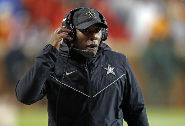 FILE - In this Nov. 30, 2019, file photo, Vanderbilt head coach Derek Mason talks on the headset in the first half of an NCAA college football game against Tennessee in Knoxville, Tenn. Colleges around the country finished off their football signing classes this week, proudly touting scores of African-American athletes as their next big stars. A review of all 130 FBS schools found shockingly low numbers, with blacks still largely shut out of head coaching positions and even more so the prime coordinator spots. (AP Photo/Wade Payne, File)