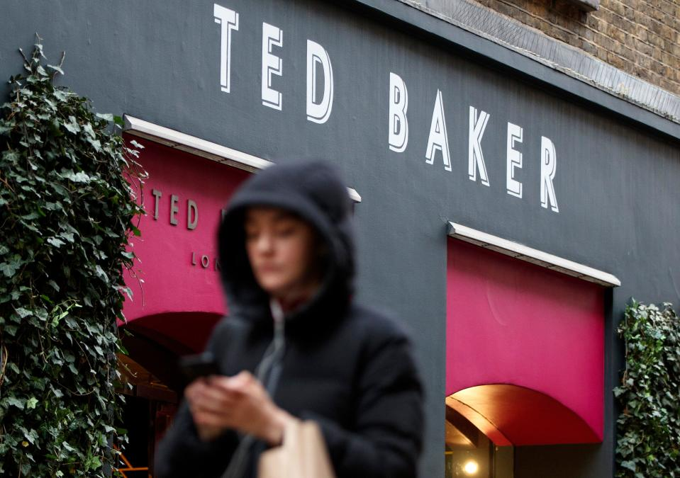 Pedestrians walk past a Ted Baker clothing store in London on December 10, 2019. - British fashion brand Ted Baker on Tuesday said both its top bosses had quit, as it warned on profits and suspended its dividend on weak consumer spending amid economic uncertainties. The group has replaced chief executive Lindsay Page with finance director Rachel Osborne on an interim basis less than a year after Page taking charge. (Photo by Tolga Akmen / AFP) (Photo by TOLGA AKMEN/AFP via Getty Images)