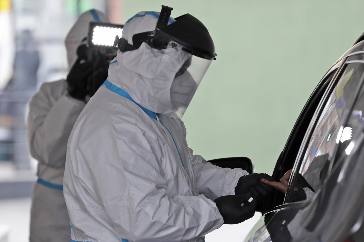 A person's blood is collected for testing of coronavirus antibodies at a drive-thru testing site in Hempstead, N.Y., Tuesday, April 14, 2020. The test, being administered by Somos Community Care, takes approximately 15 minutes and tests for the presence of antibodies in a person's blood, signifying that they may have some immunity to the coronavirus. (AP Photo/Seth Wenig)