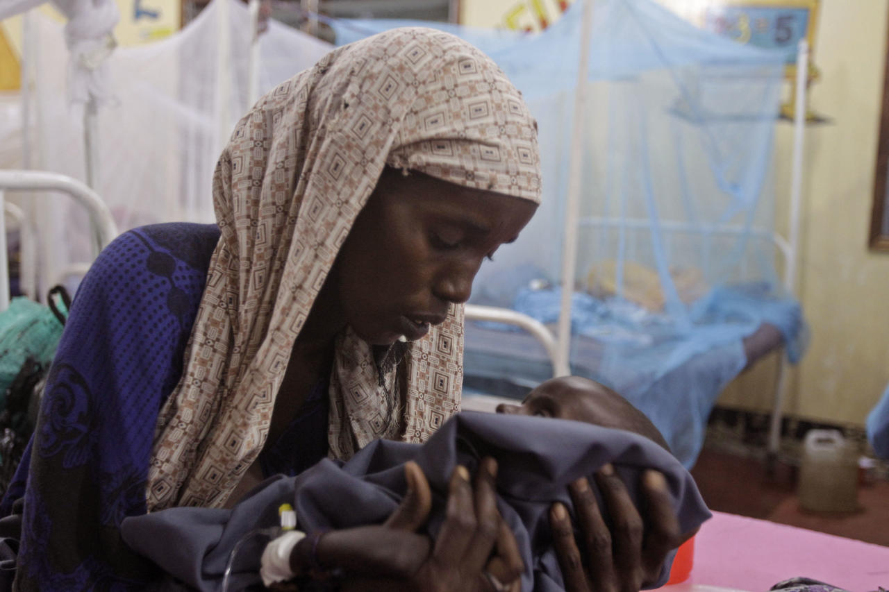 Asiah Dagane holds Mihag Gedi Farah, her seven month old child with a weight of 7 pounds, 8 ounces (3.4 kilograms) at a field hospital of the International Rescue Committee, IRC, in the town of Dadaab, Kenya, Tuesday, July 26, 2011. Mihag Gedi Farah is 7 months old, and weighs as little as a newborn with the weathered skin of an old man. His mother managed to get him to a field hospital in a Kenyan refugee camp after a weeklong odyssey, but the baby's anguished eyes, hollow cheeks and fragile limbs show just how severe Somalia's famine is becoming. (AP Photo/Schalk van Zuydam)